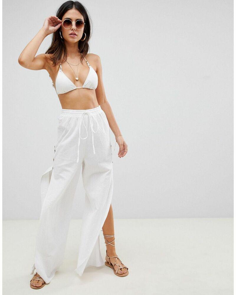 phối đồ nữ đi biển với áo bra + quần ống rộng màu trắng